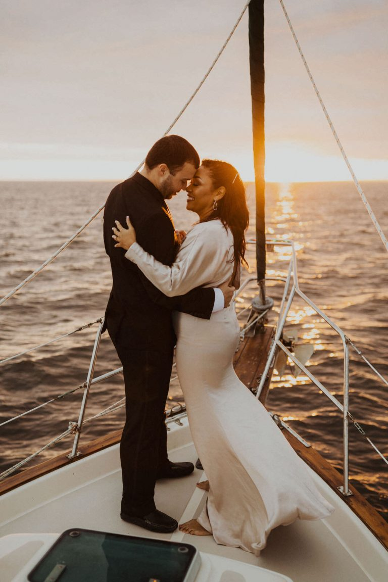 Couple slow dancing on sailboat, engagement photos